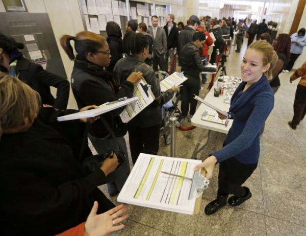Voters line-up to register and cast their early votes at the City-County Building Monday, Nov. 5, 2012, in Indianapolis.