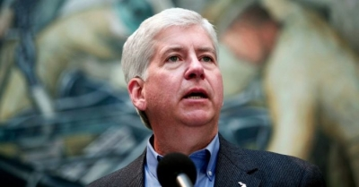 Michigan Governor Rick Snyder speaks at a press conference at the Detroit Institute of Arts June 9, 2014 in Detroit, Michigan.