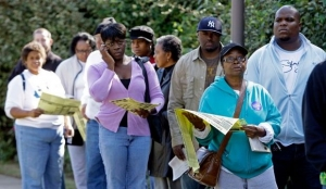 Voters stand in line at an early voting site in Charlotte, North Carolina, in October 2008.