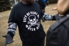 A shirt worn by a man during a rally displays a poisonous logo alongside the text 'City of Flint MI Water Dept.' on January 24, 2016 at Flint City Hall.