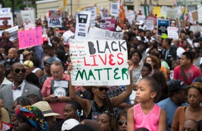 Demonstrators protest the death of Eric Garner on August 23, 2014, in Staten Island.