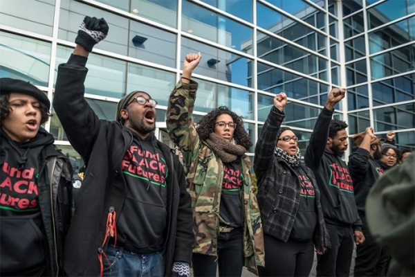 Members of BYP100's Chicago chapter rally on January 16 at the Fraternal Order of Police credit union demanding that the city divest from the police department.
