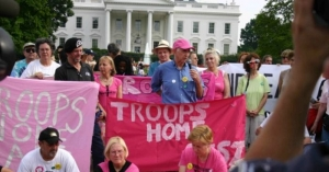 Daniel Ellsberg at the microphone with Medea Benjamin of CodePink on the left, during a 2006 hunger strike at the White House.