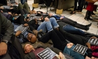 Protesters Stage a 'Die In' in Longworth Cafeteria