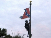 'This flag comes down today': Black activist arrested for scaling flagpole and removing Confederate flag from South Carolina's Capitol - but state workers raise it again
