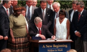 Lillie Harden (left) at the signing ceremony of President Bill Clinton's welfare reform bill.