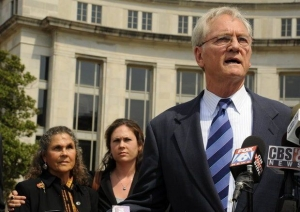 Former Gov. Don Siegelman speaks in front of the courthouse after his resentencing on Aug. 3, 2012 in Montgomery, Ala. His wife Lori and daughter Dana stand behind him.