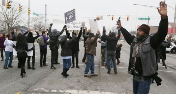 Demonstrators block Calumet Avenue at Highland Street for a short period Sunday during a Black Lives Matter demonstration at the Hammond City Hall.